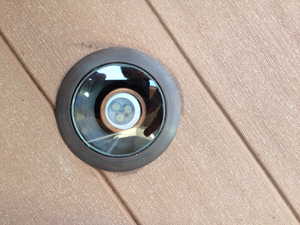 Core drilled LED inset lights on composite deck