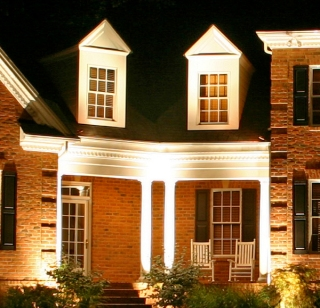 As you walk up to this home, lit by Outdoor Lighting Perspectives of St. Louis, you won't notice any visible items like tranformers that divert your eye from the beauty of the lighting.