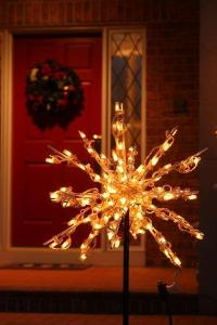 Elegant lighted starbursts welcome guests to the front door of this St. Louis home